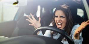 Furious woman screaming in car